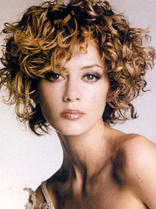 Curly Hair Short Hairstyles The Back Is Tapered Into The Neck Blending Into The Layers That Frame Her Side Of The Face Jpg Best Curly Hairstyles